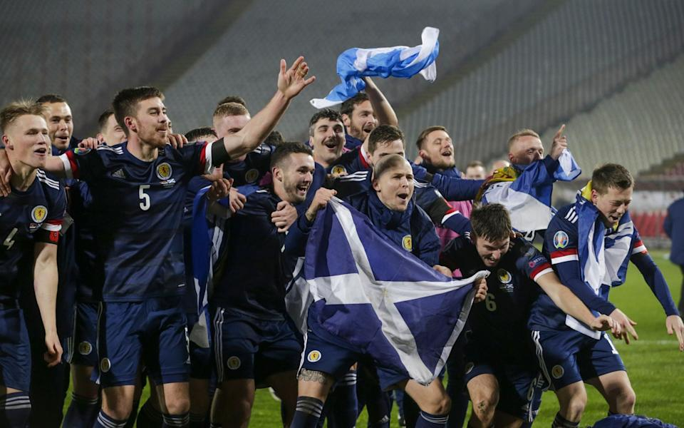 Scotland's players celebrate after winning the penalty shootout of the UEFA EURO 2020 qualification playoff match between Serbia and Scotland i - Shutterstock