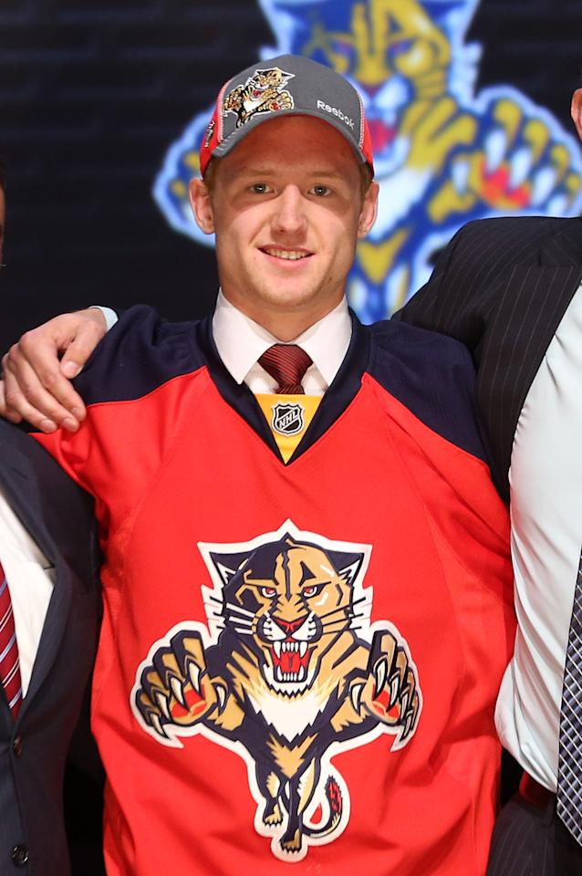 PITTSBURGH, PA - JUNE 22: Michael Matheson, 23rd overall pick by the Florida Panthers, poses on stage during Round One of the 2012 NHL Entry Draft at Consol Energy Center on June 22, 2012 in Pittsburgh, Pennsylvania.  (Photo by Bruce Bennett/Getty Images)