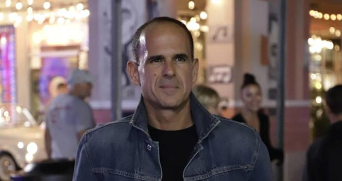 Marcus Lemonis stands at the intersection of SW Eighth Street and 15th Avenue during a scene from 'Streets of Dreams,' airing on CNBC at 10 p.m. Tuesday Jan. 12.