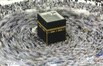 In this picture taken with a slow shutter speed, far smaller crowds than usual of Muslim pilgrims circumambulate the Kaaba, the cubic building at the Grand Mosque, in the Muslim holy city of Mecca, Saudi Arabia, Wednesday, March 4, 2020. The coronavirus outbreak disrupted Islamic worship in the Middle East as Saudi Arabia on Wednesday banned its citizens and other residents of the kingdom from performing the pilgrimage in Mecca, while Iran canceled Friday prayers in major cities. (AP Photo/Amr Nabil)