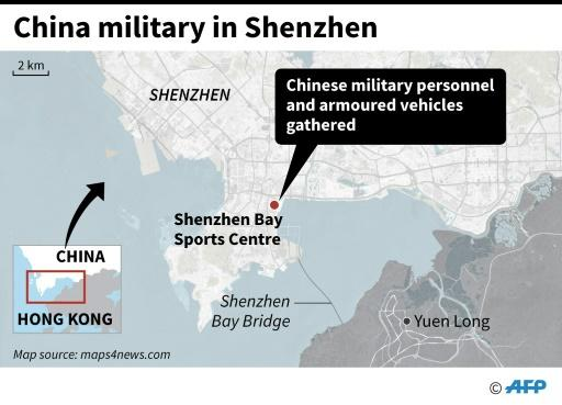 Map showing a stadium in the southern Chinese city of Shenzhen where thousands of military personnel and armoured vehicles were seen gathered on Thursday
