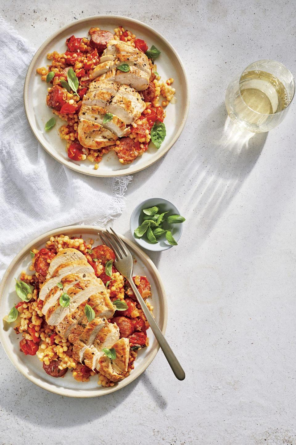 """<p><strong>Recipe: </strong><a href=""""https://www.southernliving.com/recipes/tomato-basil-couscous-chicken-sausage"""" rel=""""nofollow noopener"""" target=""""_blank"""" data-ylk=""""slk:Tomato-Basil Couscous with Chicken and Smoked Sausage"""" class=""""link rapid-noclick-resp""""><strong>Tomato-Basil Couscous with Chicken and Smoked Sausage</strong></a></p> <p>This one-pan dinner looks elegant enough for company, but this budget-friendly recipe comes together in less than 30 minutes.</p>"""