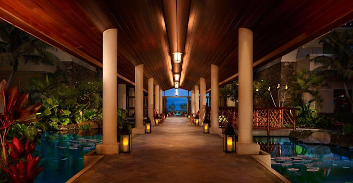 An open-air walkway at the Montage Kapalua Bay.
