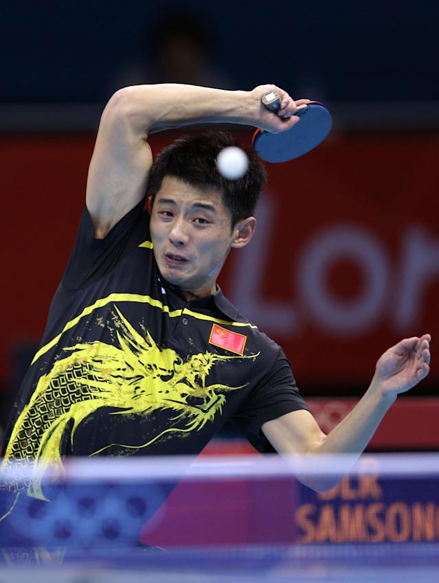 LONDON, ENGLAND - JULY 30: Zhang Jike of China returns the ball during his Men's Singles Table Tennis fourth round match against Vladimir Samsonov of Belarus on Day 3 of the London 2012 Olympic Games at ExCeL on July 30, 2012 in London, England. (Photo by Feng Li/Getty Images)