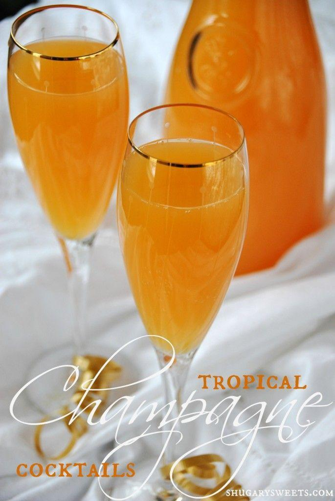 """<p>Give your cocktail a tropical twist with orange juice and fruit punch.</p><p>Get the recipe from <a href=""""http://www.shugarysweets.com/2012/12/tropical-champagne-cocktails"""" rel=""""nofollow noopener"""" target=""""_blank"""" data-ylk=""""slk:Shugary Sweets"""" class=""""link rapid-noclick-resp"""">Shugary Sweets</a>.</p>"""