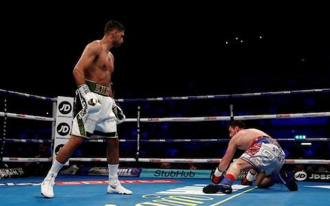 Amir Khan knocks down Phil Lo Greco  - Credit: REUTERS