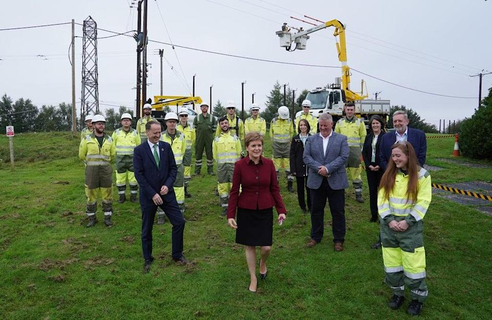 First Minister Nicola Stugeon, with Scottish Power chief executive Keith Anderson (left) and some of the company's apprentice engineers (Andrew Milligan/PA) (PA Wire)