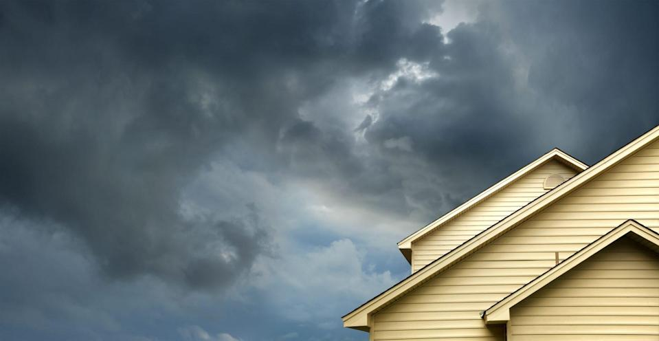 House Roof with Storm Clouds Above