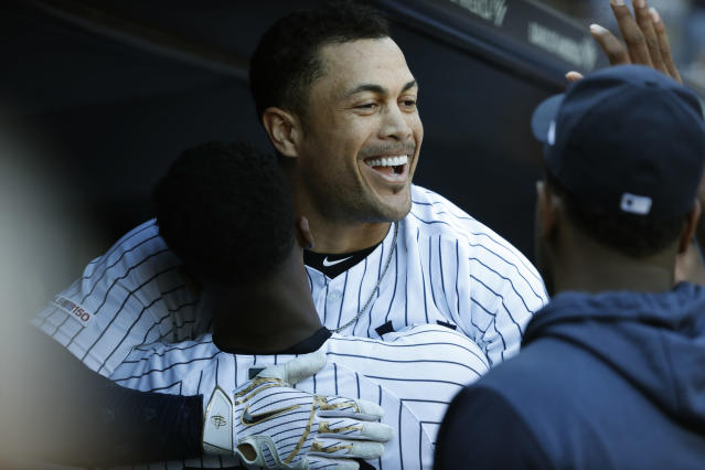 New York Yankees' Giancarlo Stanton celebrates with New York Yankees' Didi Gregorius after hitting a home run against the Toronto Blue Jays during the sixth inning of the team's baseball game, Saturday, Sept. 21, 2019, in New York. (AP Photo/Michael Owens)