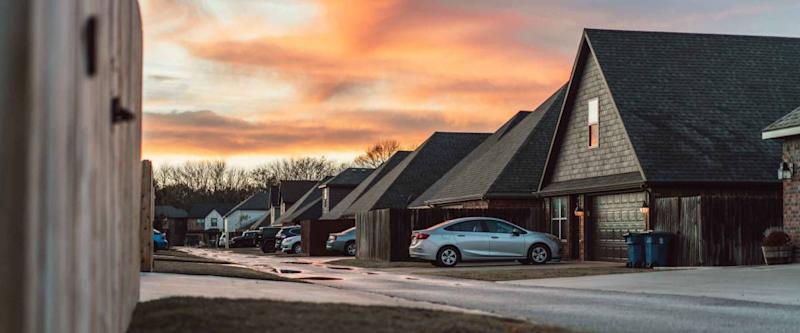 Living in Residential Housing Neighborhood Street at Sunset in Bentonville Arkansas