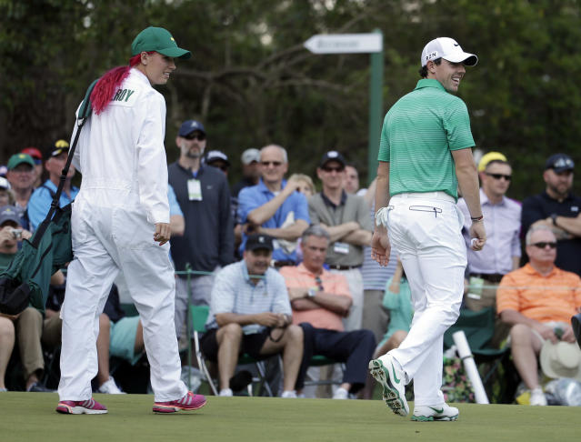 Tennis player Caroline Wozniacki walks with her fiancee Rory McIlroy, of Northern Ireland, during the par three competition at the Masters golf tournament Wednesday, April 9, 2014, in Augusta, Ga. (AP Photo/Darron Cummings)