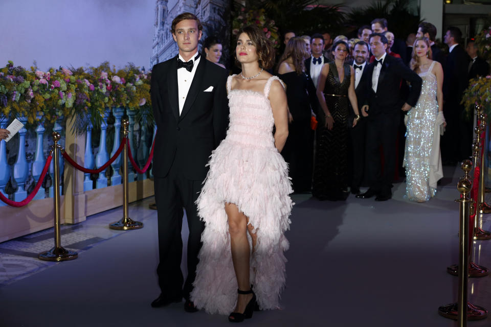 "Pierre and Charlotte Casiraghi arrive for the annual Rose Ball at the Monte-Carlo Sporting Club in Monaco, on March 23, 2013.. The Rose Ball is one of the major charity events in Monaco. Created in 1954, it benefits the Princess Grace Foundation. Directed by German Couturier Karl Lagerfeld, this year's event named ""La Belle Epoque"" (Beautiful Era), was celebrated in honor of the Societe des bains de mer (SBM),  a prominent player in Monaco's tourism industry. AFP PHOTO /POOL/ VALERY HACHE        (Photo credit should read VALERY HACHE/AFP via Getty Images)"
