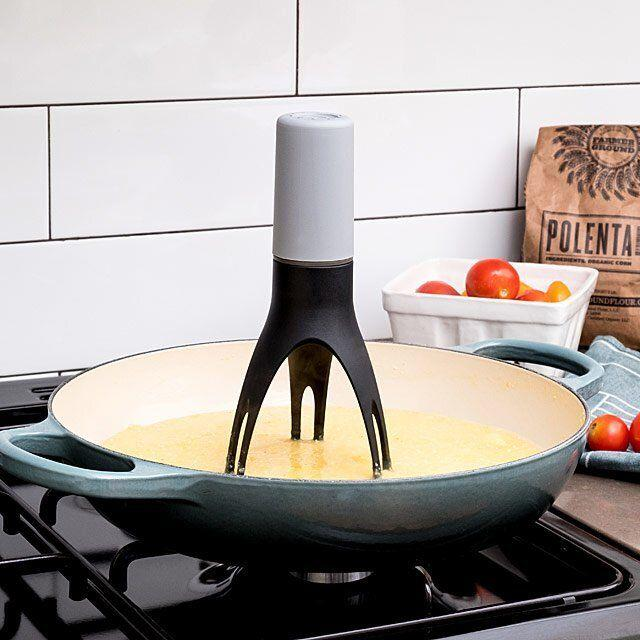 """After you own this tool, you won't have to spend the full half-hour before every meal babysitting the stove. For dishes on a low simmer, you can set the timer on this and go back to watching Netflix the way nature intended.<br /><br /><strong>Promising review:</strong>""""Honestly I laughed at myself for buying this. I stopped laughing the first time I used it! What a help!<strong>It freed me up to do other things while it stirred the sauce that needed constant attention.</strong>Bought another one! Not laughing now!"""" —Luvdvm<br /><br />Get it from Uncommon Goods for<a href=""""https://go.skimresources.com?id=38395X987171&xs=1&xcust=HPEfficientKitchenProducts-60993864e4b0f73e531037cd-&url=https%3A%2F%2Fwww.uncommongoods.com%2Fproduct%2Fautomatic-pan-stirrer-with-timer"""" target=""""_blank"""" rel=""""nofollow noopener noreferrer"""" data-skimlinks-tracking=""""5842859"""" data-vars-affiliate=""""Impact Radius"""" data-vars-asin=""""none"""" data-vars-campaign=""""EfficientKitchenProductsLord1-21-21-5842859"""" data-vars-href=""""http://uncommongoods.sjv.io/c/468058/483884/8444?subId1=EfficientKitchenProductsLord1-21-21-5842859&u=https%3A%2F%2Fwww.uncommongoods.com%2Fproduct%2Fautomatic-pan-stirrer-with-timer"""" data-vars-keywords=""""cleaning"""" data-vars-link-id=""""16294094"""" data-vars-price="""""""" data-vars-product-id=""""1"""" data-vars-product-img=""""none"""" data-vars-product-title=""""Placeholder- no product"""" data-vars-redirecturl=""""https://www.uncommongoods.com/product/automatic-pan-stirrer-with-timer"""" data-vars-retailers="""""""" data-ml-dynamic=""""true"""" data-ml-dynamic-type=""""sl"""" data-orig-url=""""http://uncommongoods.sjv.io/c/468058/483884/8444?subId1=EfficientKitchenProductsLord1-21-21-5842859&u=https%3A%2F%2Fwww.uncommongoods.com%2Fproduct%2Fautomatic-pan-stirrer-with-timer"""" data-ml-id=""""3"""">$25</a>."""