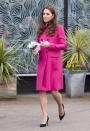 <p>The duchess didn't ditch the brighter colors, turning up at a charity appearance in a hot pink Mulberry coat. (Photo: PA) </p>