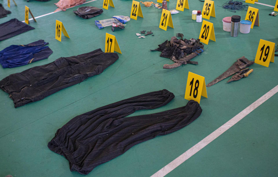 Evidence items which belonged to suspected militants, Ali Kalora and Jaka Ramadan, are seen during a press conference at the Parigi Moutong Police Station in Parigi Moutong district, Central Sulawesi, Indonesia, Sunday, Sept. 19, 2021. Indonesia's most wanted militant with ties to the Islamic State group was killed Saturday in a shootout with security forces, the Indonesian military said, in a sweeping counterterrorism campaign against extremists in the remote mountain jungles. (AP Photo/Mohammad Taufan)