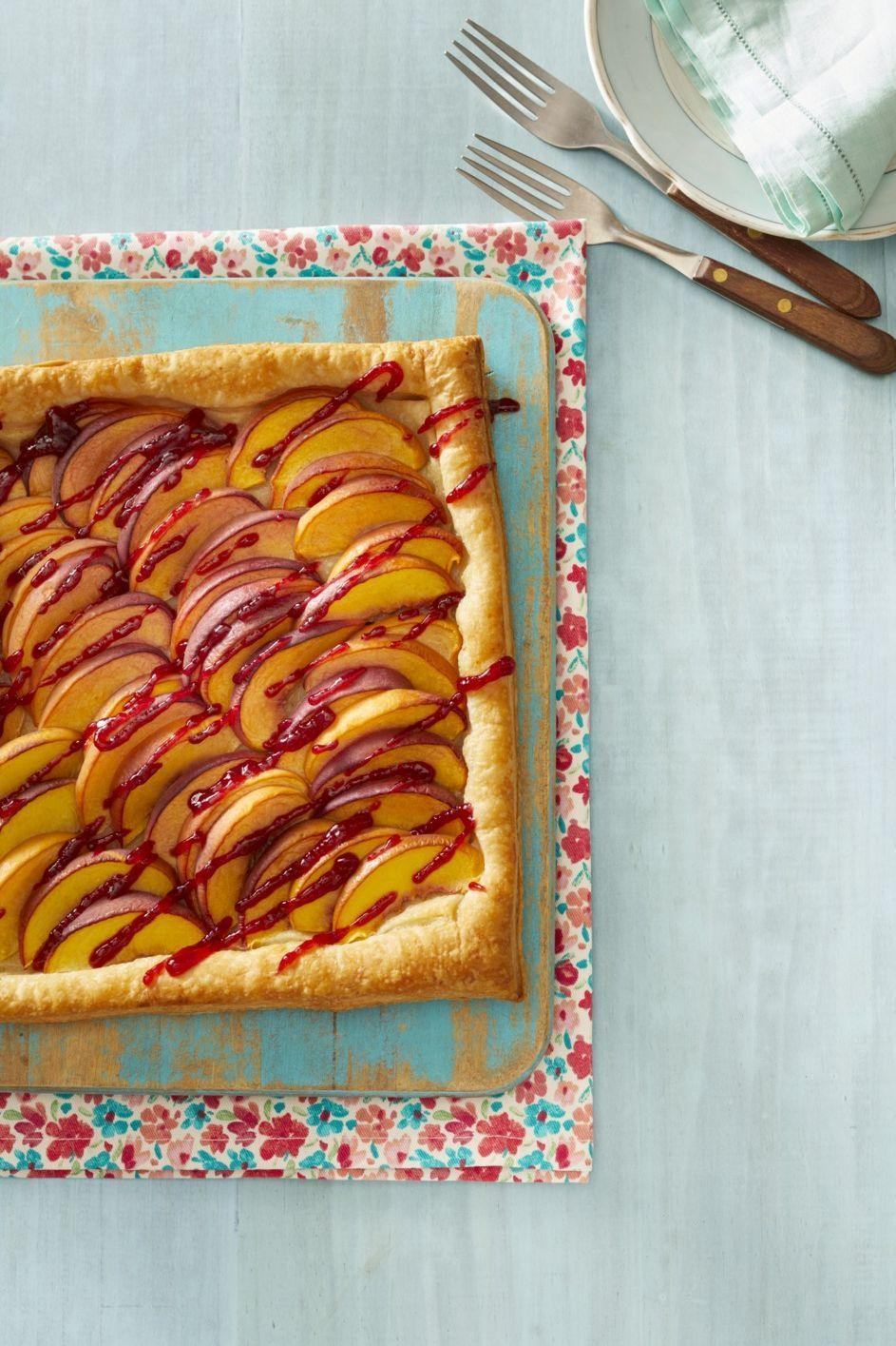 """<p>Instead of your typical pie crust, this sheet-pan tart is made with frozen puff pastry. It couldn't be easier—but your guests don't have to know that! </p><p><a href=""""https://www.thepioneerwoman.com/food-cooking/recipes/a32096774/peach-melba-tart-recipe/"""" rel=""""nofollow noopener"""" target=""""_blank"""" data-ylk=""""slk:Get Ree's recipe."""" class=""""link rapid-noclick-resp""""><strong>Get Ree's recipe. </strong></a></p><p><a class=""""link rapid-noclick-resp"""" href=""""https://go.redirectingat.com?id=74968X1596630&url=https%3A%2F%2Fwww.walmart.com%2Fsearch%2F%3Fquery%3Dbaking%2Bsheet&sref=https%3A%2F%2Fwww.thepioneerwoman.com%2Ffood-cooking%2Fmeals-menus%2Fg36558208%2Fsummer-pie-recipes%2F"""" rel=""""nofollow noopener"""" target=""""_blank"""" data-ylk=""""slk:SHOP BAKING SHEETS"""">SHOP BAKING SHEETS</a></p>"""