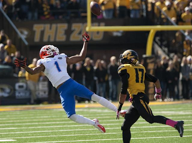 Florida wide receiver Quinton Dunbar, left, misses a pass in front of Missouri's Matt White, right, during the second quarter of an NCAA college football game Saturday, Oct. 19, 2013, in Columbia, Mo. (AP Photo/L.G. Patterson)