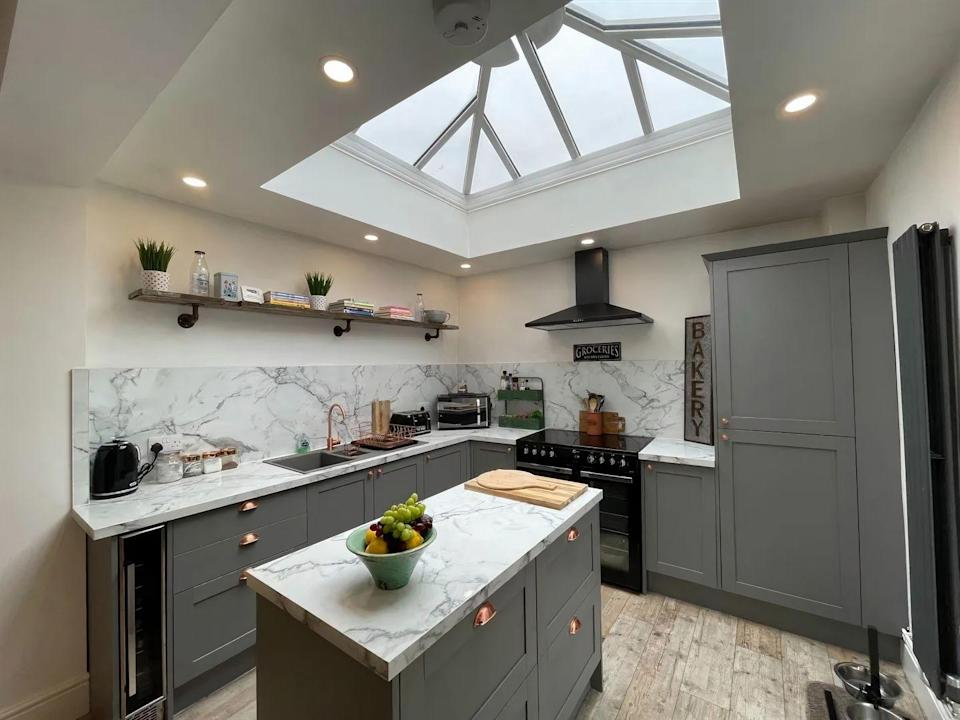 <p>Kitchen goals! We're big fans of the marble worktops, skylight and grey cabinets. </p>