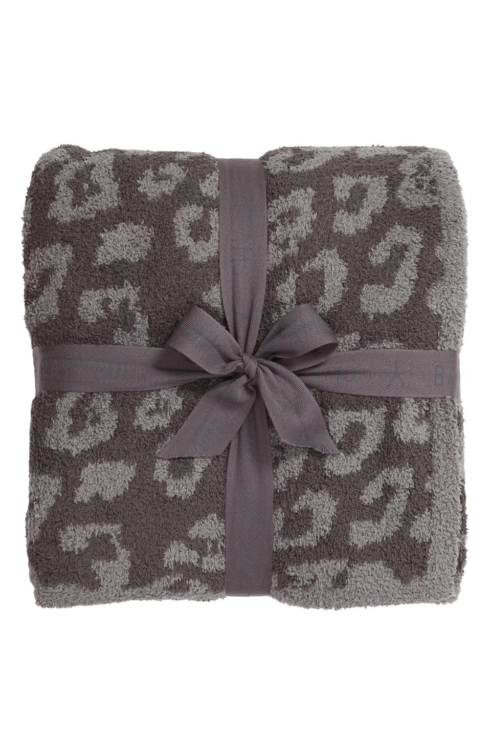"""<p><strong>BAREFOOT DREAMS</strong></p><p>nordstrom.com</p><p><strong>$180.00</strong></p><p><a href=""""https://go.redirectingat.com?id=74968X1596630&url=https%3A%2F%2Fwww.nordstrom.com%2Fs%2Fbarefoot-dreams-in-the-wild-throw-blanket%2F3362118&sref=https%3A%2F%2Fwww.housebeautiful.com%2Fshopping%2Fbest-stores%2Fg37155428%2Fnordstrom-anniversary-sale-home-deals-2021%2F"""" rel=""""nofollow noopener"""" target=""""_blank"""" data-ylk=""""slk:BUY NOW"""" class=""""link rapid-noclick-resp"""">BUY NOW</a></p><p>This fluffy, microfiber throw makes afternoon reading or nap sessions feel like a luxury spa treatment. It effortlessly adds style to your living room or bedroom.</p>"""