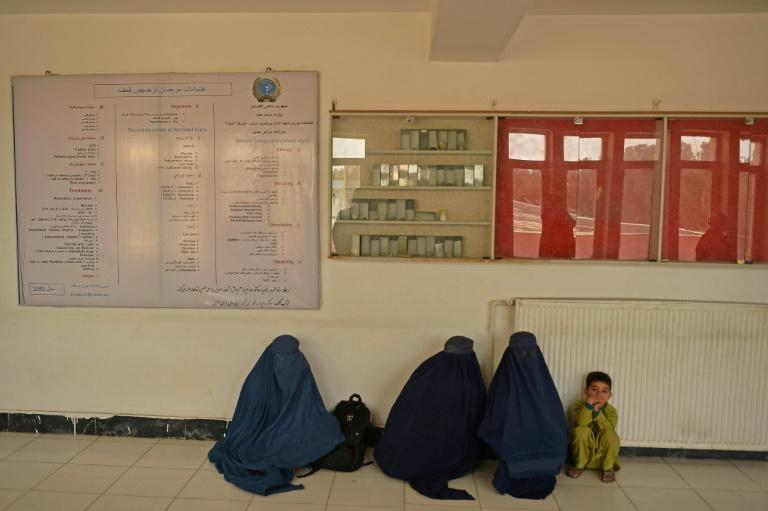 Families wait at the regional hospital in Kunduz where victims of the suicide bombing at the Gozar-e-Sayed mosque are being treated (AFP/Hoshang Hashimi)
