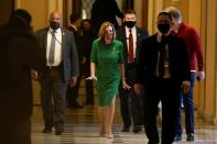 Speaker of the House Nancy Pelosi (D-CA) walks back to her office after opening the House floor following an agreement of a coronavirus disease (COVID-19) aid package, in Washington