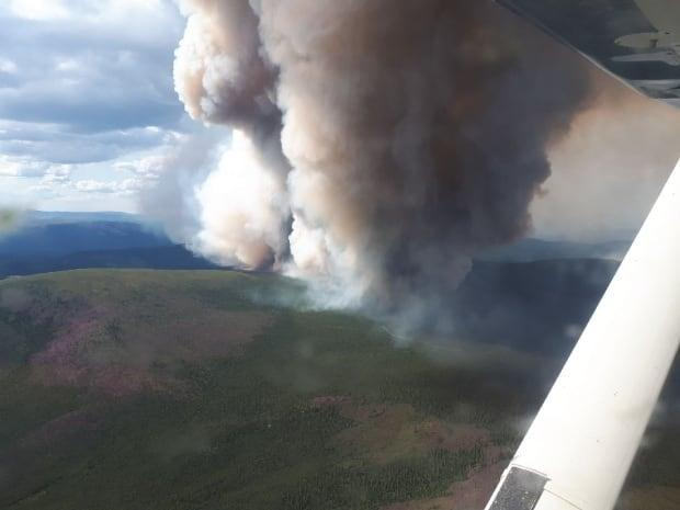A 21,279-hectare wildfire burning about 43 kilometres southeast of Old Crow on Tuesday. Officials said Wednesday that no buildings or infrastructure were immediately at risk. (Yukon Protective Services - image credit)