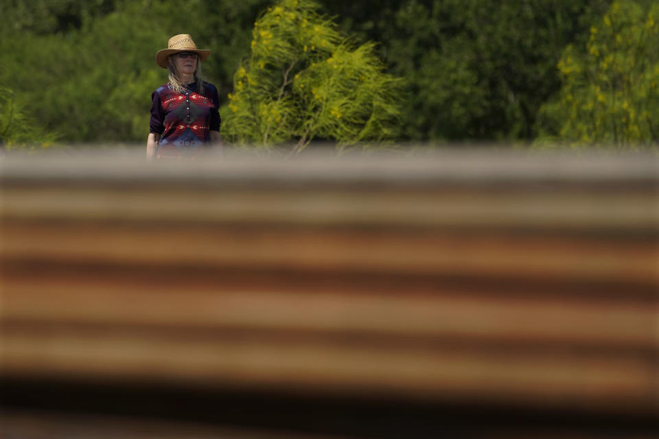 Molly Rooke checks on an abandoned well at her family ranch that was being plugged, Tuesday, May 18, 2021, near Refugio, Texas. Rooke, who co-owns the family ranch had an orphaned well blow out on her property, spewing chemicals into the air. The 15,000-acre ranch contained dozens of orphaned, unplugged wells, with pipes not much taller than her own frame. (AP Photo/Eric Gay)