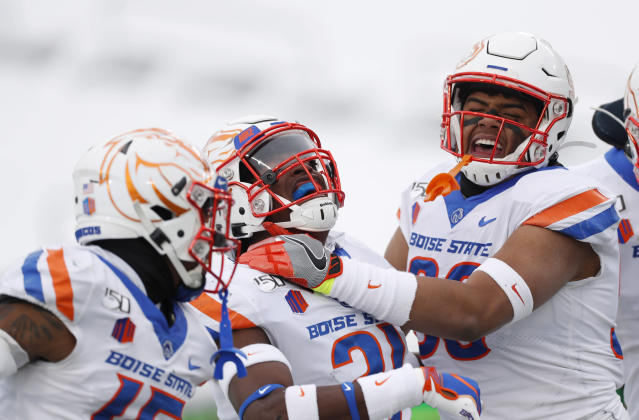Boise State defensive back Tyreque Jones, center, celebrates intercepting a pass with cornerback Jalen Walker, left, and linebacker Curtis Weaver in the first half of an NCAA college football game against Colorado State Friday, Nov. 29, 2019, in Fort Collins, Colo. (AP Photo/David Zalubowski)