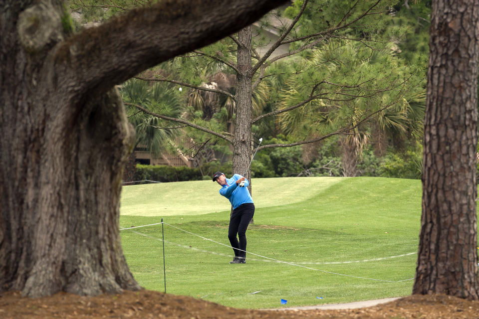 Stewart Cink hits out of the rough on the 10th hole during the second round of the RBC Heritage golf tournament in Hilton Head Island, S.C., Friday, April 16, 2021. (AP Photo/Stephen B. Morton)