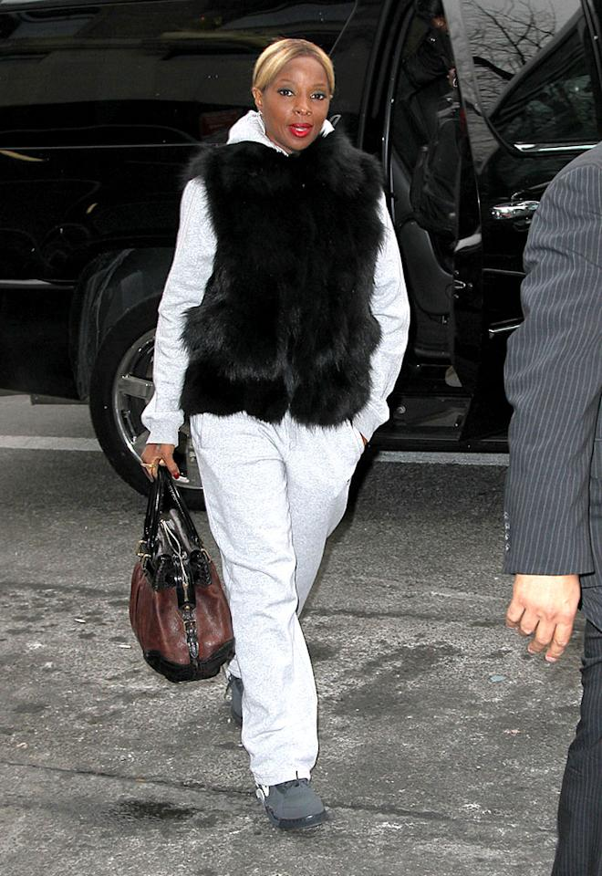 Mary J Blige arrives at her hotel in New York City, wearing sweats and a faux fur waistcoat
