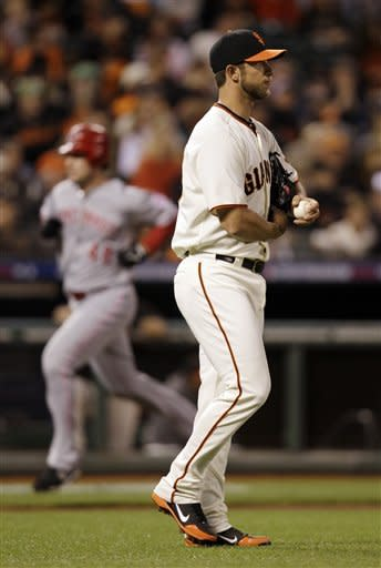 Cincinnati Reds' Ryan Ludwick rounds the bases after he hit a solo home run off of San Francisco Giants pitcher Madison Bumgarner, right, in the second inning during Game 2 of the National League division baseball series in San Francisco, Sunday, Oct. 7, 2012. (AP Photo/Eric Risberg)