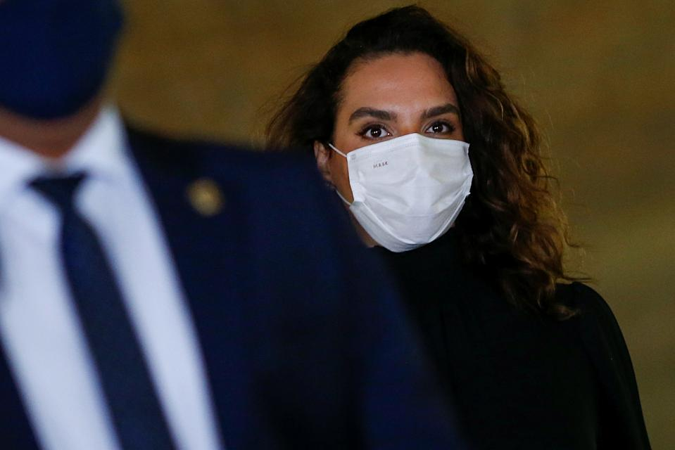 Doctor Luana Araujo walks before a meeting of the Parliamentary Inquiry Committee (CPI) to investigate government actions and management during the coronavirus disease (COVID-19) pandemic, at the Federal Senate in Brasilia, Brazil June 2, 2021. REUTERS/Adriano Machado