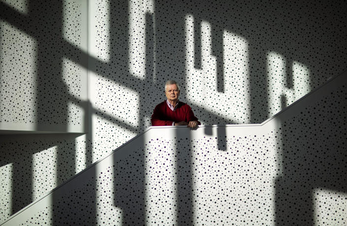 """Brown University professor Stephen Kinzer, author of a book on the mind-control experiment backed by the CIA which gave large doses of LSD to prisoners including James """"Whitey"""" Bulger, stands outside his office, Thursday, Jan. 30, 2020, in Providence, R.I. """"During its peak in the 1950s, that program and it's director, Sidney Gottlieb, left behind a trail of broken bodies and shattered minds across three continents."""" (AP Photo/David Goldman)"""