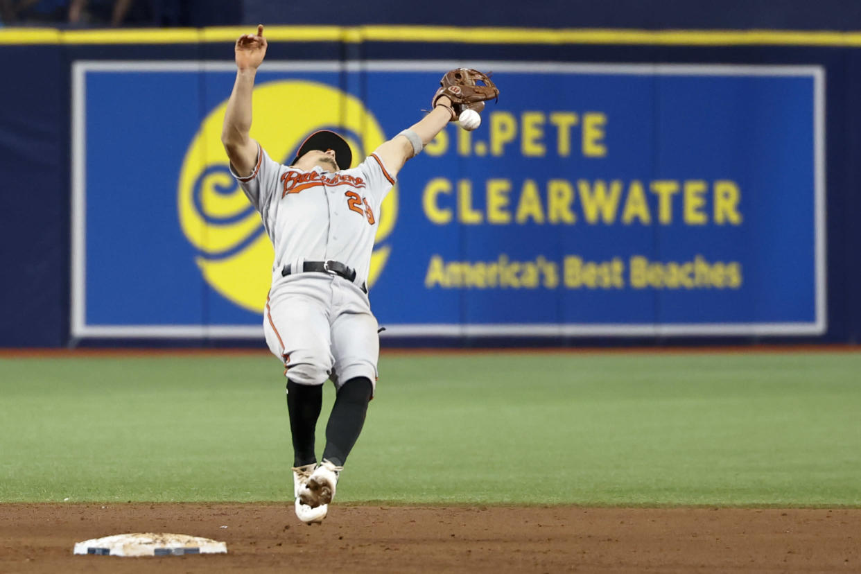 Ramon Urias of the Baltimore Orioles attempts to catch a pop fly causing a run to score on an error against the Rays. (Photo by Douglas P. DeFelice/Getty Images)