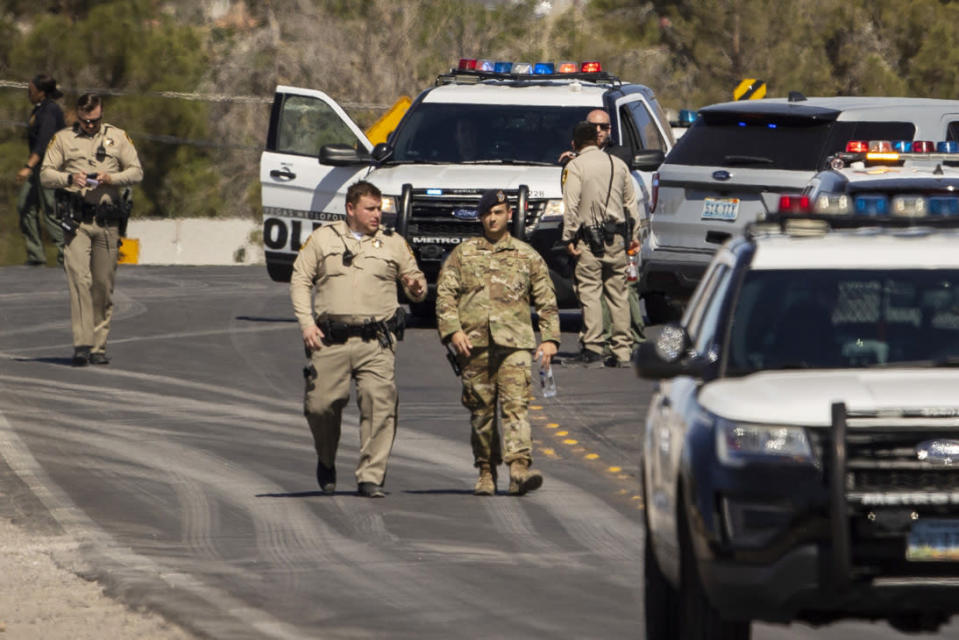 Las Vegas police and military personnel respond to an airplane crash near Nellis Air Force Base on Monday, May 24, 2021, in Las Vegas. (L.E. Baskow/Las Vegas Review-Journal via AP)