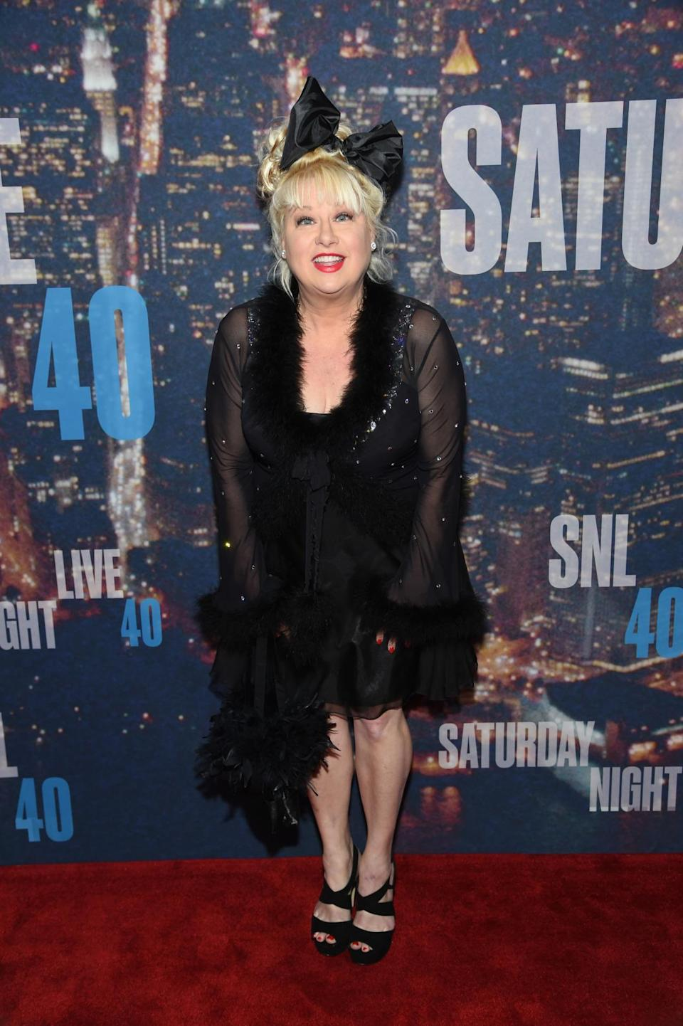"""Victoria Jackson channeled """"Material Girl"""" era Madonna with her lingerie-like dress and big bow in her hair."""
