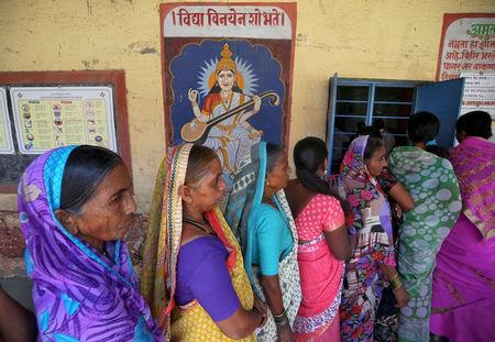 FILE PHOTO: Women wait to cast their votes at a polling station during the third phase of general election on the outskirts of Pune, India, April 23, 2019. REUTERS/Francis Mascarenhas/File Photo