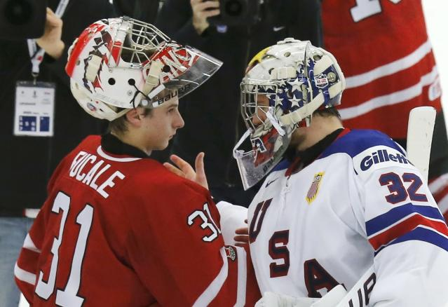 Canada's goalie Zachary Fucale (L) is congratulated by United States' goalie Jon Gillies after Canada defeated the United States in their IIHF World Junior Championship ice hockey game in Malmo, Sweden, December 31, 2013. REUTERS/Alexander Demianchuk (SWEDEN - Tags: SPORT ICE HOCKEY)