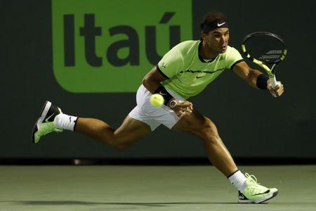 Mar 29, 2017; Miami, FL, USA; Rafael Nadal of Spain reaches for a forehand against Jack Sock of the United States (not pictured) on day nine of the 2017 Miami Open at Crandon Park Tennis Center. Nadal won 6-2, 6-3. Mandatory Credit: Geoff Burke-USA TODAY Sports