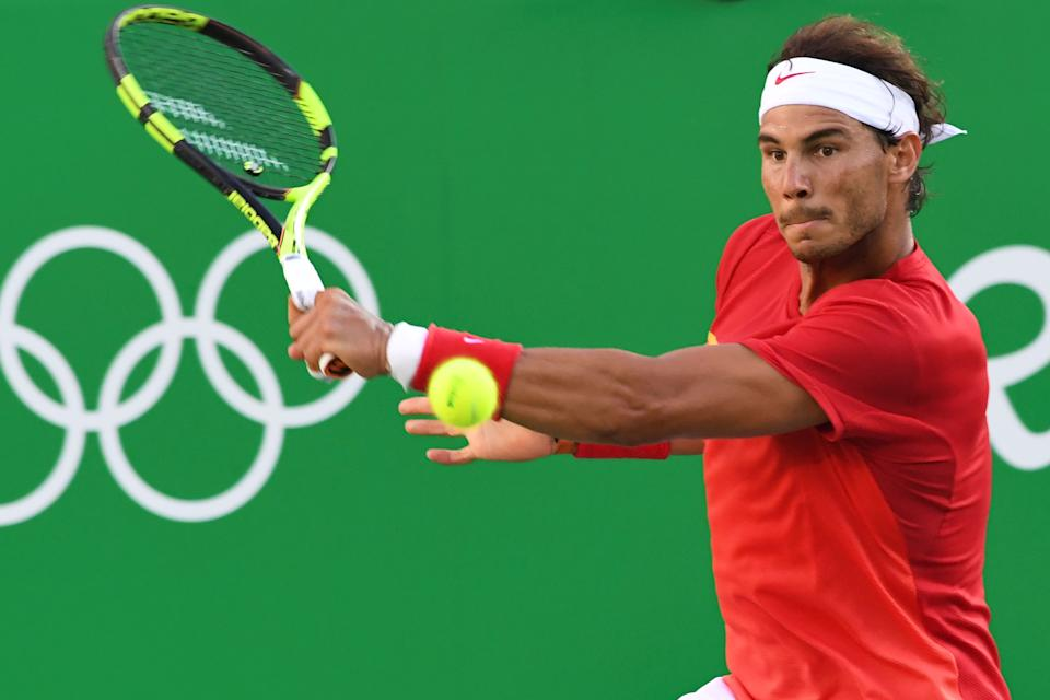 Spain's Rafael Nadal returns the ball to Argentina's Juan Martin Del Potro during their men's singles semi-final tennis match at the Olympic Tennis Centre of the Rio 2016 Olympic Games in Rio de Janeiro on August 13, 2016. / AFP / Luis Acosta        (Photo credit should read LUIS ACOSTA/AFP via Getty Images)