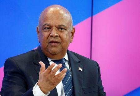 FILE PHOTO: Pravin Gordhan, minister of finance of South Africa, attends the World Economic Forum meeting in Davos, Switzerland, January 19, 2017.  REUTERS/Ruben Sprich/File Photo