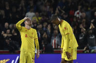 Liverpool's Andrew Robertson, left, and Liverpool's Joel Matip react after the English Premier League soccer match between Brentford and Liverpool at the Brentford Community Stadium in London, Saturday, Sept. 25, 2021. (AP Photo/Rui Vieira)