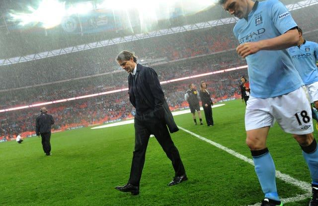 Mancini was sacked shortly after City lost the 2013 FA Cup final to Wigan (Anthony Devlin/PA).