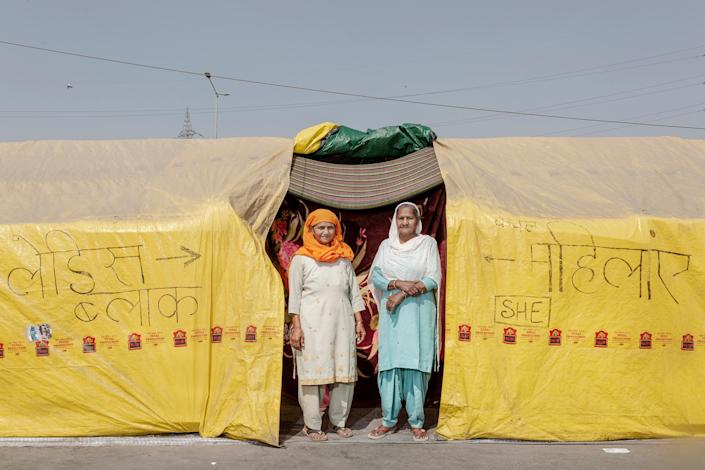 "Sarjit Kaur, left, and Dilbeer Kaur, right, from Rampur, Uttar Pradesh, have been at the protests for two months. ""We are here to show solidarity and support,"" Dilbeer says. Prime Minister Modi is ""making us leave our farms and sit here to fight for our rights. We are here to get these laws repealed, and we will be here till we get it done.""<span class=""copyright"">Kanishka Sonthalia for TIME</span>"