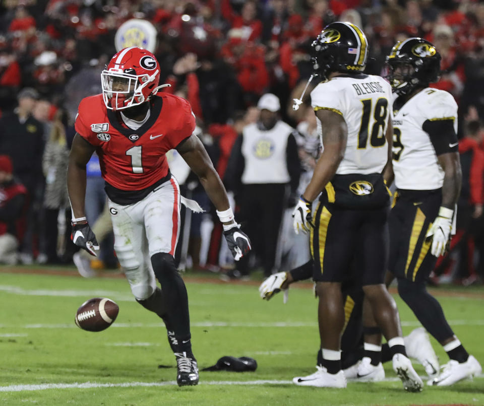 CORRECTS DATELINE TO ATHENS, GA., INSTEAD OF ATLANTA - Georgia wide receiver George Pickens gets into the endzone past Missouri defenders for a touchdown during the first quarter of an NCAA college football game on Saturday, Nov. 9, 2019, in Athens, Ga. (Curtis Compton/Atlanta Journal-Constitution via AP)