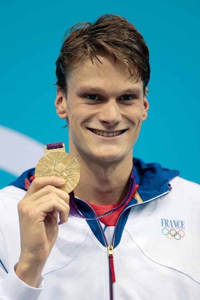 LONDON, ENGLAND - JULY 30: Gold medalist Yannick Agnel of France celebrates with his medal during the medal cermony for the Men's 200m Freestyle on Day 3 of the London 2012 Olympic Games at the Aquatics Centre on July 30, 2012 in London, England. (Photo by Adam Pretty/Getty Images)