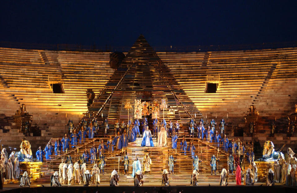 """FILE - In this June 21, 2002 file photo, a huge pyramid dominates the stage of the opening performance of Giuseppe Verdi's Aida in the Verona Arena, northern Italy. Riccardo Muti will open the season on June 19 and 22, conducting a concert version of """"Aida"""" to mark the 150th anniversary of the Verdi title whose pageantry has made it a festival mainstay. (AP Photo/Claudio Martinelli)"""
