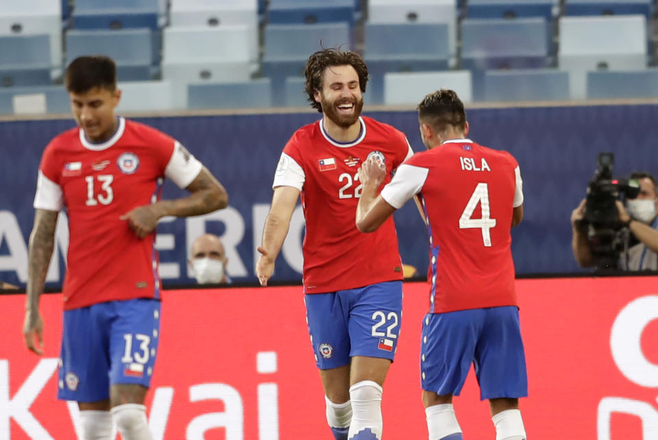 Chile's Ben Brereton, center, celebrates scoring his side's opening goal against Bolivia during a Copa America soccer match at Arena Pantanal stadium in Cuiaba, Brazil, Friday, June 18, 2021. (AP Photo/Andre Penner)