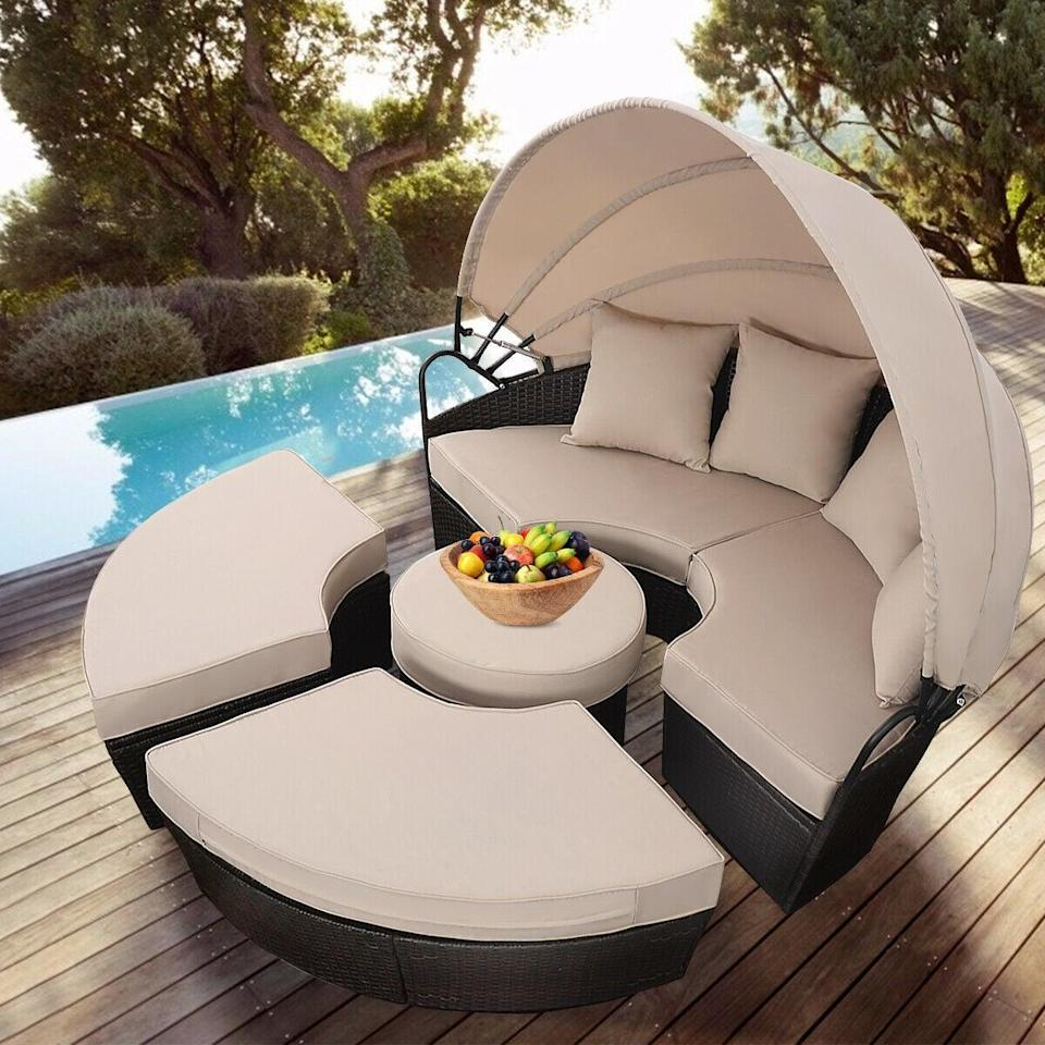 <p>You'll want to lounge on this <span>Costway Outdoor Retractable Canopy Daybed</span> ($570) all day.</p>