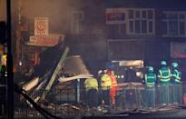 Members of the emergency services work at the site of an explosion which destroyed a convenience store and a home in Leicester, Britain, February 25, 2018. REUTERS/Darren Staples